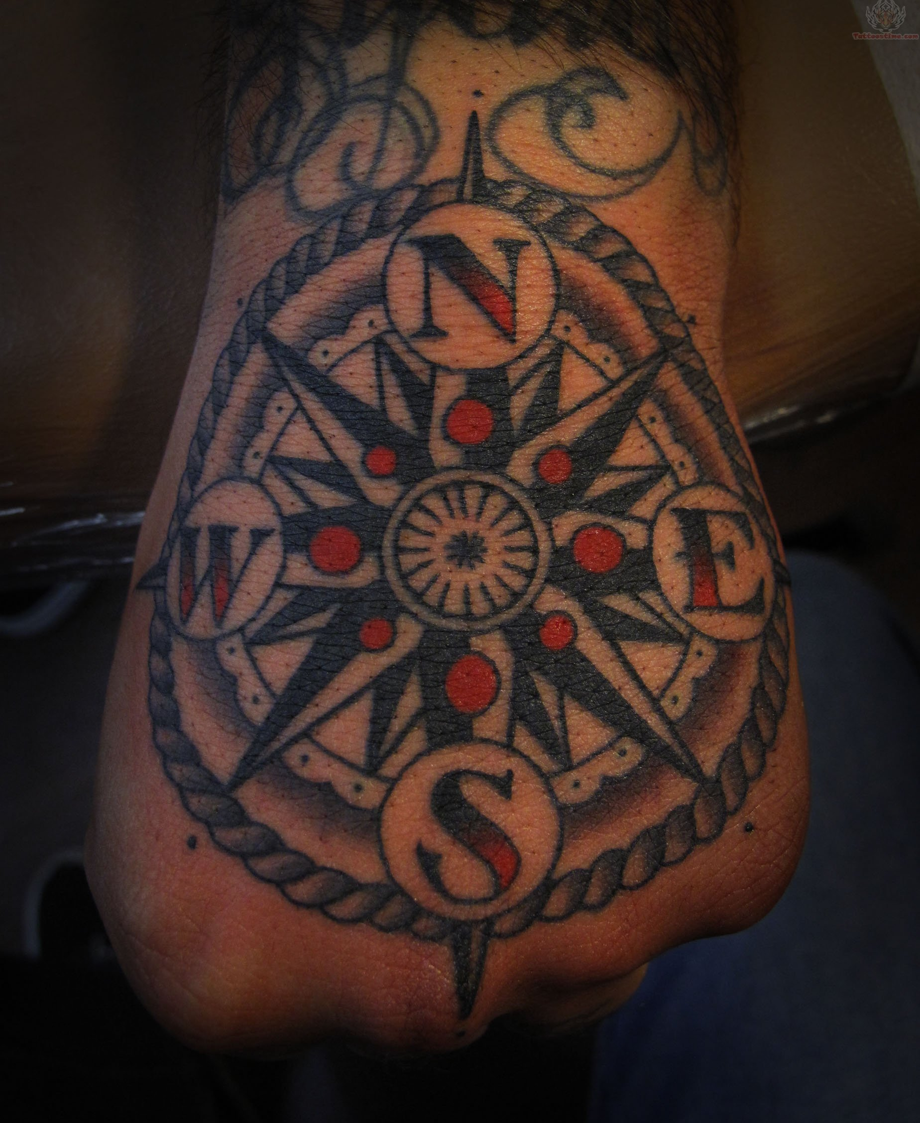 color-ink-compass-tattoo-on-hand